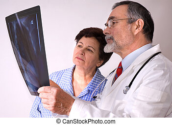 X-ray - doctor and patient looking at an X-ray