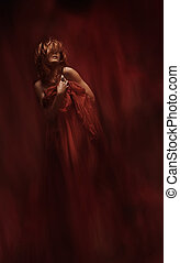 sensual woman in red fabric over art abstract background