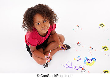 Little African Asian girl painting on the floor - Cute...