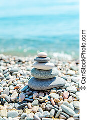 stack of zen stones near sea