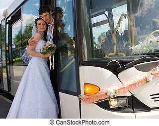 Unusual wedding transport - Young happy newlywed couple and...