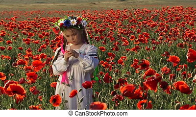 Among blossoming poppies - Ukrainian girl in a field among...