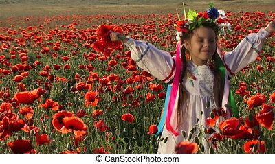 Among blooming poppies - Ukrainian girl in a field among...