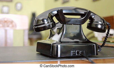 Vintage black telephone Man dials