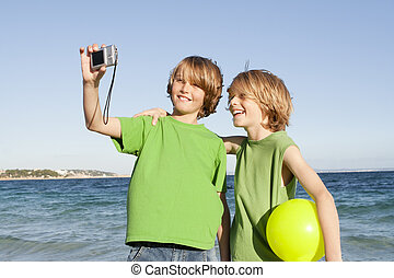 kids on vacation or holiday - happy smiling kids on vacation
