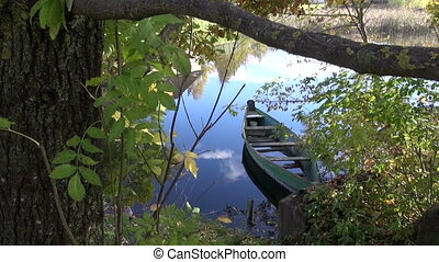 old lonely wooden  boat in river