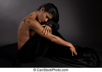 dark beauty - Beautiful exotic woman on black background...