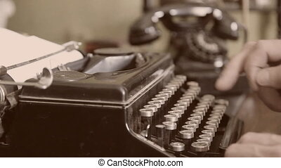 Desk Vintage typewriter, old phone Sepia