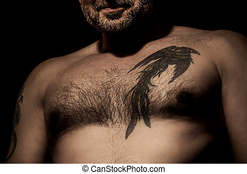 man with tattoo - An image of a handsome man with a tattoo