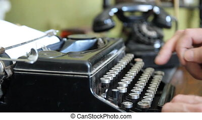 Desk Vintage typewriter, old phone