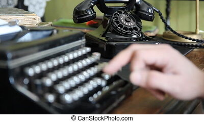 Desk. Vintage typewriter, old phone