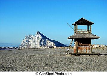 Rock of Gibraltar and beach. - View along the beach towards...