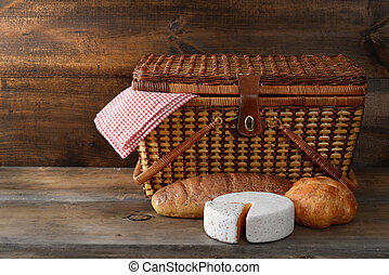 picnic basket with bread and cheese