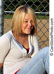 Funny Face Blond - Smiling young blond woman making a silly...