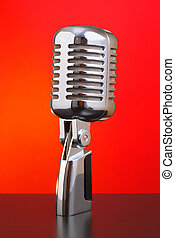 Classic microphone on red