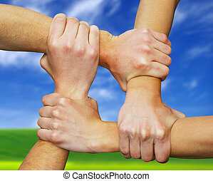 hands - Linked hands on a field background symbolizing...