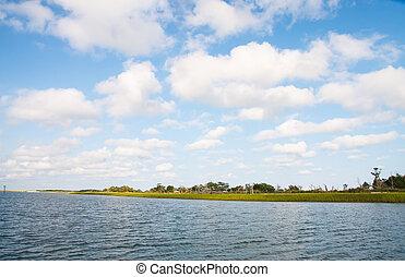 Beautiful Skies Over Coastal Salt Marsh - A coastal salt...