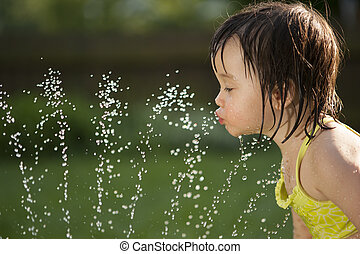 Child drinking from the water fountain - Toddler drinking...