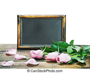 black board and pink roses - black board and pink roses on a...