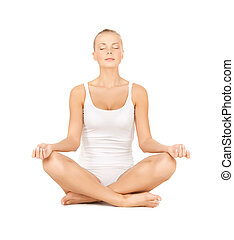woman practicing yoga - sporty woman in cotton underwear...