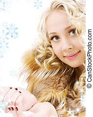 handful of ice - lovely blonde in fur with handful of ice