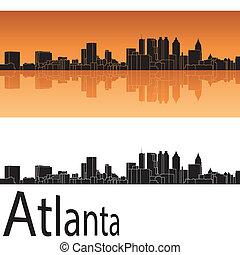 Atlanta skyline in orange background in editable vector file