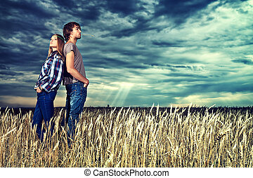 back to back - Romantic young couple in casual clothes...