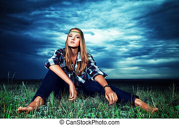 independent - Romantic young woman in casual clothes sitting...