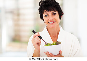 middle aged woman with healthy salad - beautiful middle aged...