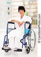 middle aged woman sitting on wheelchair