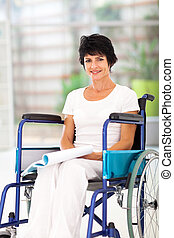 handicapped middle aged woman reading