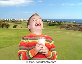 Happy child drinking milk