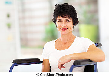 optimistic handicapped middle aged woman sitting on...