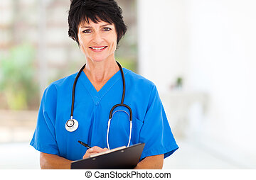 beautiful middle aged medical nurse