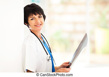 middle aged medical doctor with x-ray