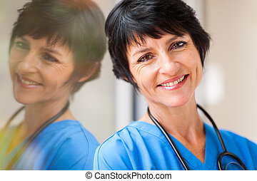 beautiful middle aged healthcare worker closeup portrait