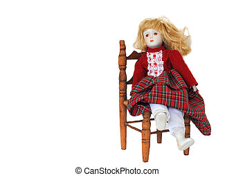 Porcelain Doll - Porcelain doll sits lady-like in a wooden...