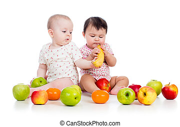 Funny children babies with healthy food fruits isolated on white background