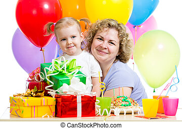 little girl and mother celebrate birthday holiday