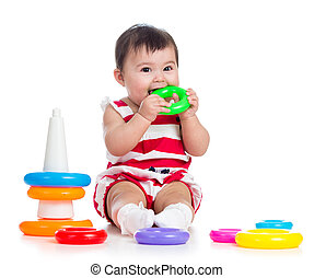 cheerful baby girl playing with colorful toy isolated on white