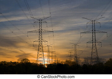 Power Towers at Sunset - Electric towers through rural area...