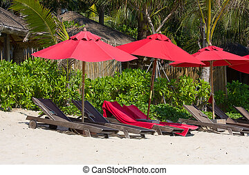Tropical beach in Thailand - Beach umbrella and deck chairs...