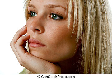 Depressed Woman - young blond woman with a depressed look on...