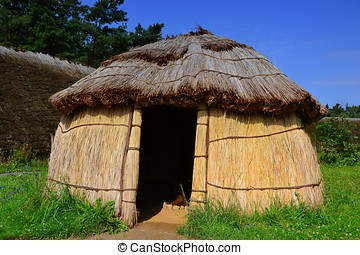 a hut in a reconstructed Stone Age village