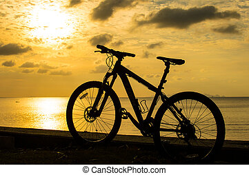 MTB - Single mountain bike silhuette on the beach.
