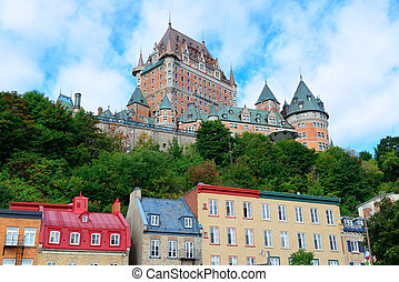 Chateau Frontenac in the day with colorful buildings on...