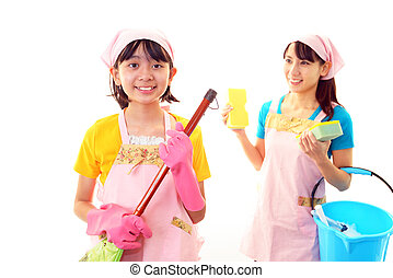 Girl clean up room with her mom - Smiling girl holding...