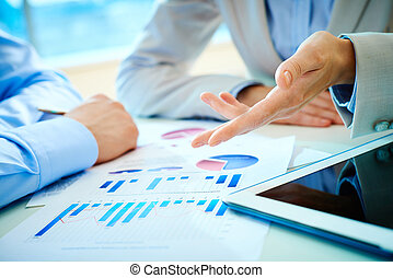 Financial report - Close-up of female hand pointing at...