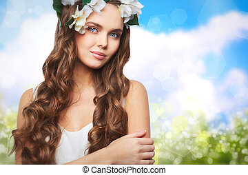 Miss Spring - Charming young woman looking at camera on...