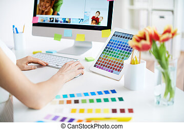 Working with colors - Female designer working with colors
